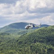 An AS350 crew assists in the hunt for escaped prisoners Richard Matt and David Sweat in upstate in NY.