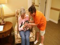 Michelle Videlock interacts with a resident