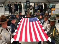 CBP officers and agents prepare to fold the U.S. flag during the Valor Memorial Ceremony