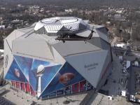 A CBP AMO helicopter flies in front of Atlanta's Mercedes-Benz Stadiuim