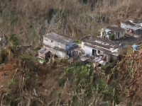Shoot of house with help written on roof in PR