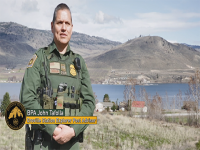 Border Patrol Agent Tafolla standing in front of mountain range