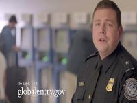 CBP officer standing inside an airport