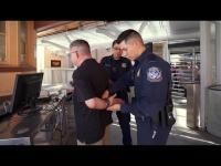 CBP officer places suspect in custody