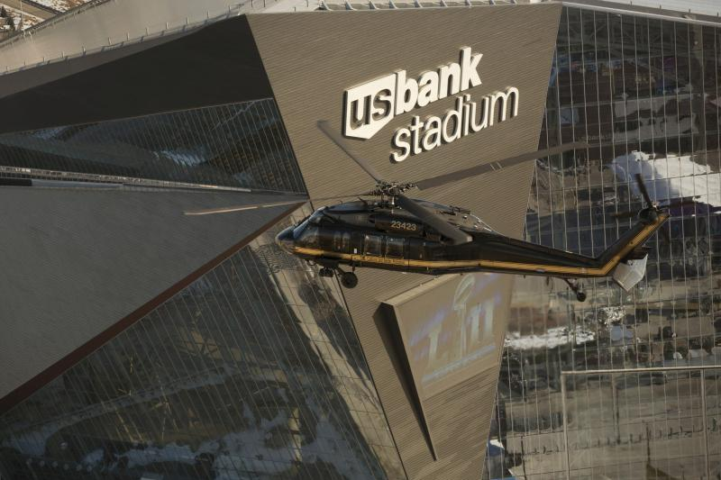 A U.S. Customs and Border Protection Air and Marine Operations UH-60 Black Hawk helicopter flies over U.S. Bank Stadium in advance of Super Bowl LII in Minneapolis, Minnesota, Jan. 29, 2018
