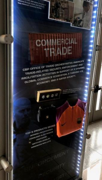 An exhibit highlighting counterfeit goods intercepted by CBP, including fake Super Bowl rings, is on display at CBP headquarters in Washington, D.C. CBP Photo