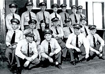 Kathleen Dixson surrounded by male inspectors in a group photo
