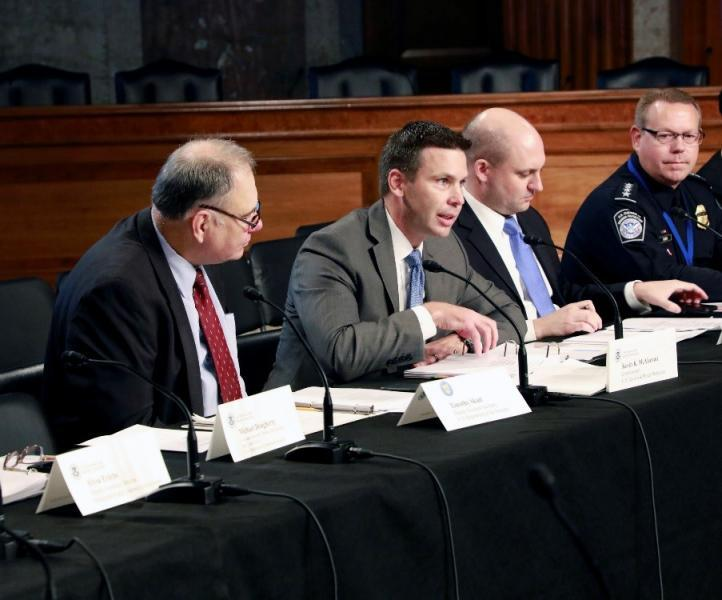 CBP Commissioner Kevin K. McAleenan, center left, delivers his opening remarks at the October 3, 2018 COAC meeting in Washington, D.C.  From left, Deputy Assistant Treasury Secretary Timothy Skud, CBP Executive Director of Trade Relations Bradley Hayes, and CBP Executive Assistant Commissioner Office of Field Operations Todd Owen.  Photo Credit: Jaime Rodriguez