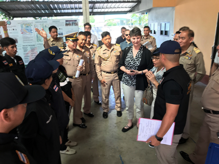 2.	Executive Assistant Commissioner Brenda Smith listens as Royal Thai Navy officials explain the port in and port out inspection processes at the port of Samut Sakhon.