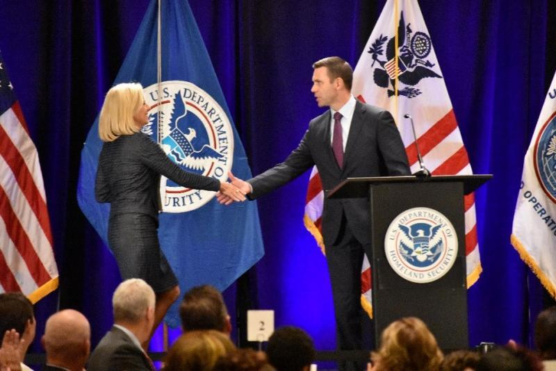 Commissioner Kevin McAleenan, right, welcomes DHS Secretary Kirstjen Nielsen to the stage at CBP's 2018 Trade Symposium in Atlanta on August 14.  Secretary Nielsen delivered the keynote luncheon address.