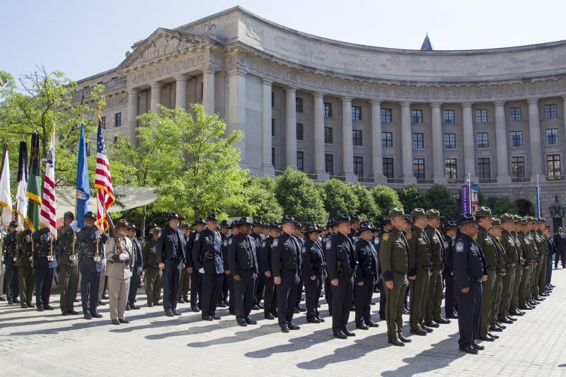 The CBP Honor Guard enters the Valor Memorial ceremony as CBP agents and officers stand in formation.