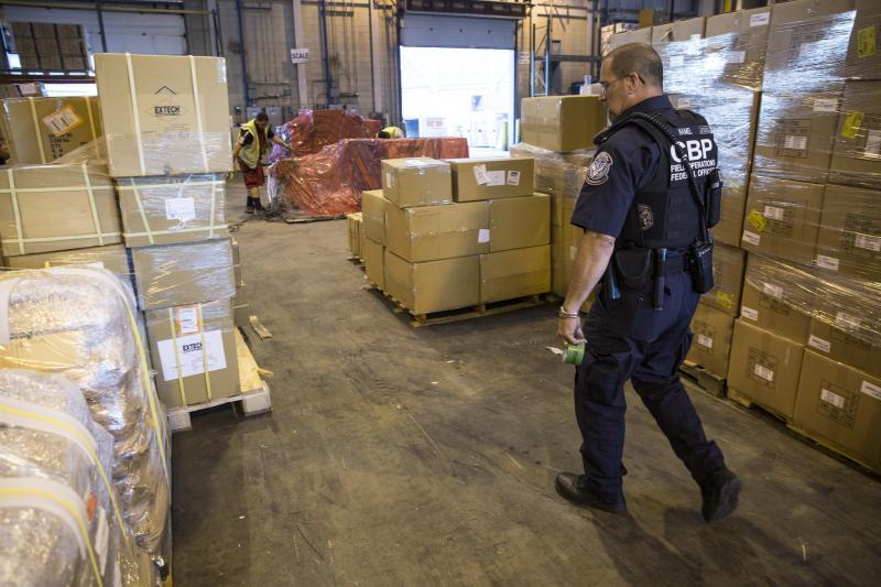 A CBP officer inspects cargo at one of CBP's 328 ports of entry