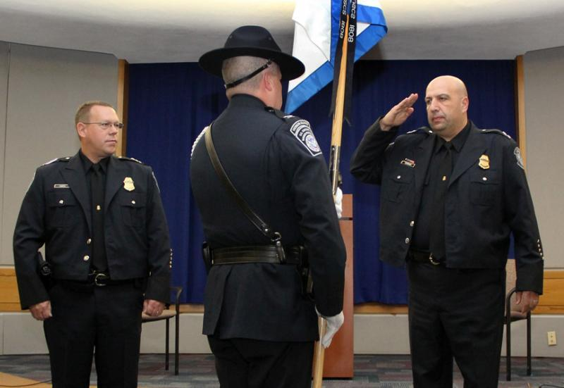 Field Operations Executive Assistant Commissioner Todd C. Owen looks on as CBP Honor Guard Commander delivers the guidon to Director of Field Operations William A. Ferrara signifying the official change of command in Boston on October 28.