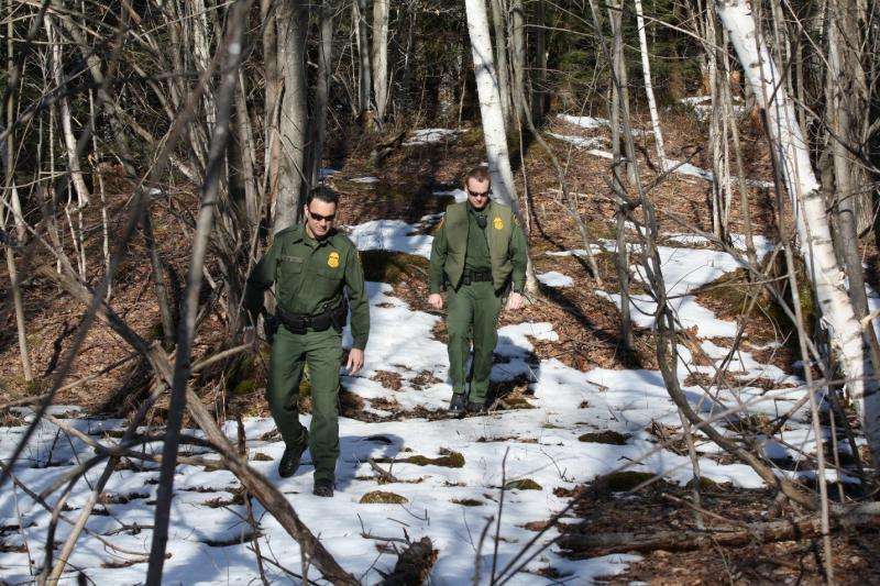 U.S. Border Patrol agents patrol along the international border in Vermont.