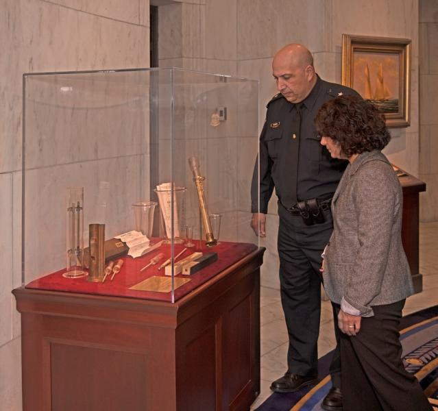 CBP Boston Director of Field Operations William A. Ferrara views one of the new displays at the Historic Boston Custom House.