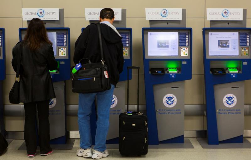 Travelers use Global Entry kiosks to speed their entry into the U.S.
