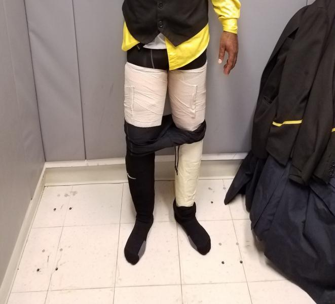 Crewmember is caught with cocaine tapped to his legs at JFK.