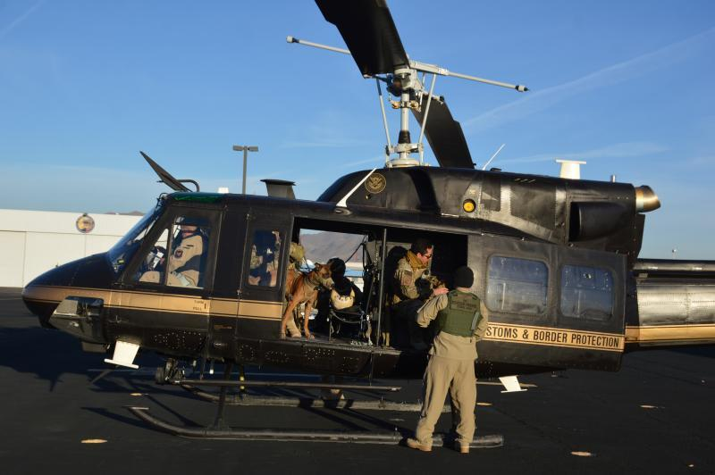 CBP Air and Marine crew and canine prepare for a flight in west Texas