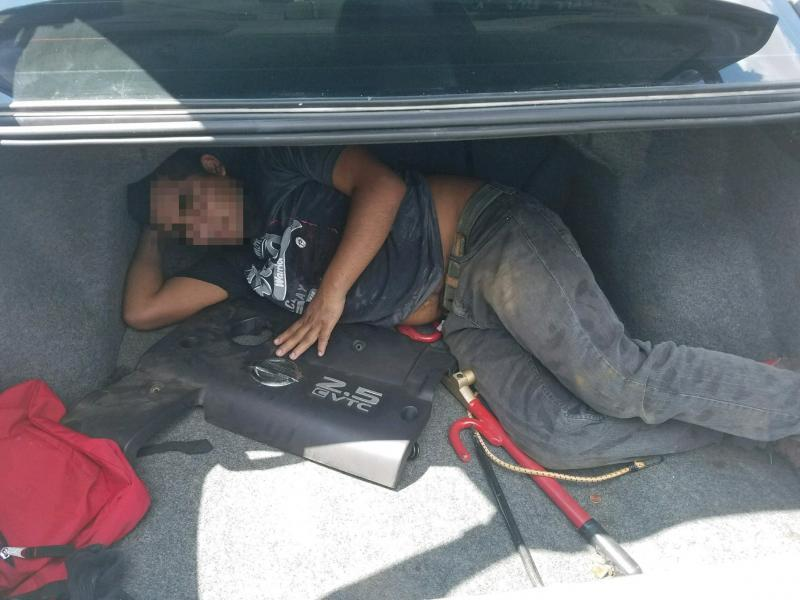 Man hiding in vehicle trunk