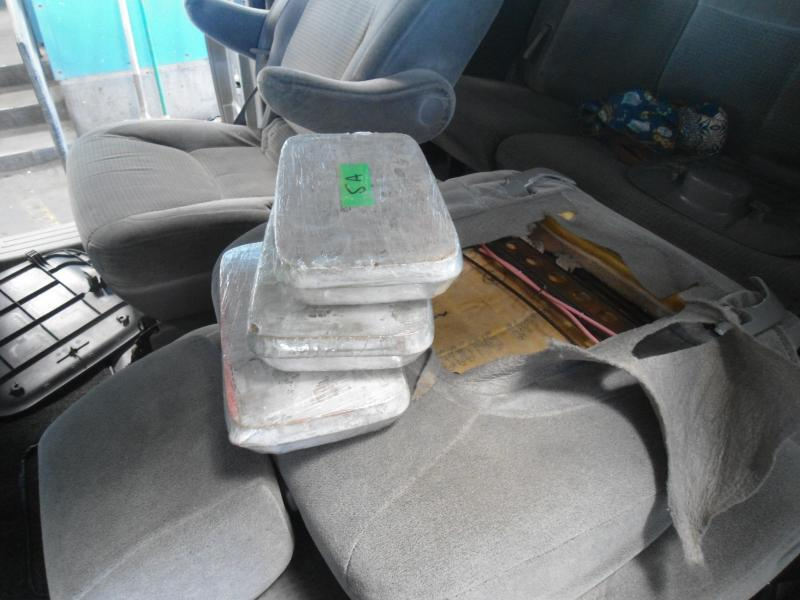 CBP officers stopped this minivan with a family of four after a canine alerted, and found 133 pounds of narcotics hidden inside.