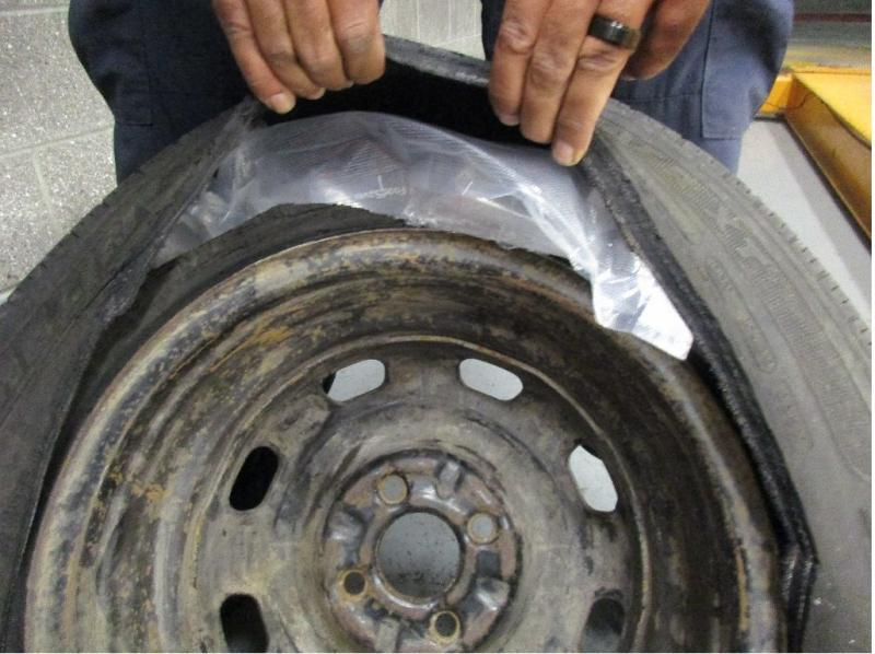 CBP officers at the San Ysidro port of entry discovered 37 wrapped packages of methamphetamine concealed in the spare tire, quarter panels and seats of a Honda Civic.