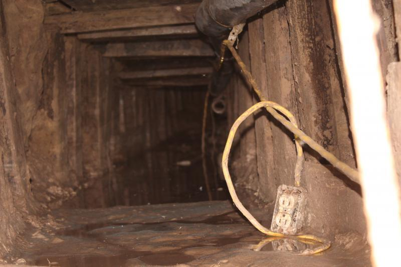 Once the hole was exposed, the agent saw lumber and electrical wiring inside, indicating the possible presence of a cross border tunnel.