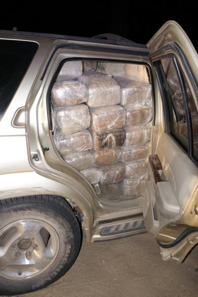 U.S. Border Patrol agents track a vehicle crossing the border from Mexico; find it abandoned and filled with bundles of marijuana.