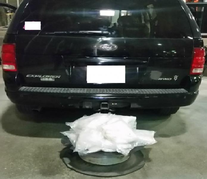 14 wrapped packages of crystal methamphetamine hidden inside the spare tire