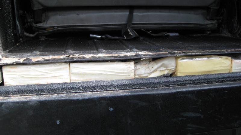 The narcotics were stashed inside a hidden compartment located in the undercarriage of the vehicle.