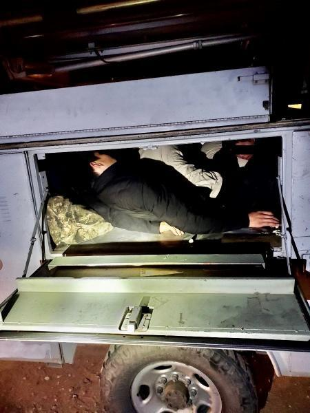 Agents discovered 14 individuals stuffed and laying on top of one another in the rear metal utility box