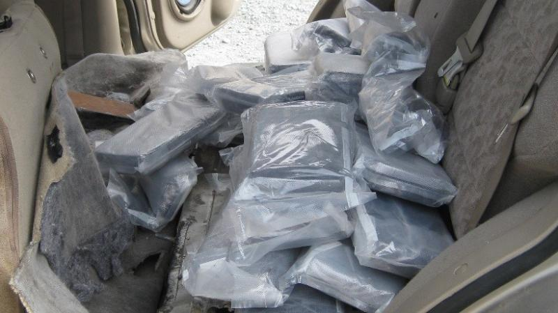 Agents discovered 34 bundles of meth inside a hidden compartment under an SUV backseat.
