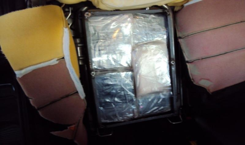 Agents discover deadlt drugs hidden in metal boxes stuffed inside seat headrests.