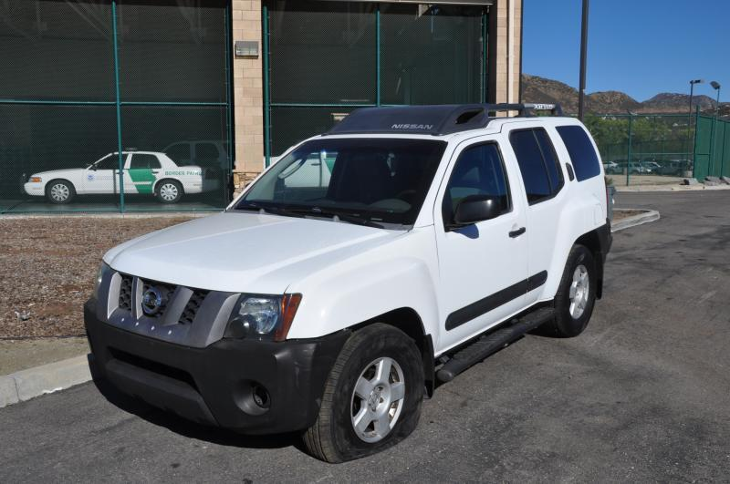 Border Patrol agents used a spike strip to flatten the tires of a Nissan Xterra