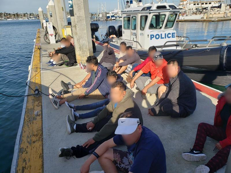 Agents arrested 21 people who crossed illegally into the U.S. in a boat