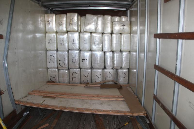 CBP offers find more than a ton of marijuana hidden in truck.