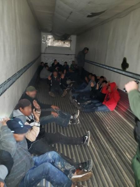 Agents arrested 26 smuggled immigrants inside a tractor-trailer.