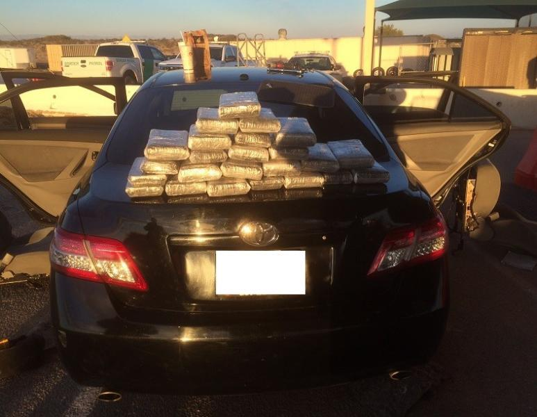 Agents pulled 24 packages of cocaine from car.