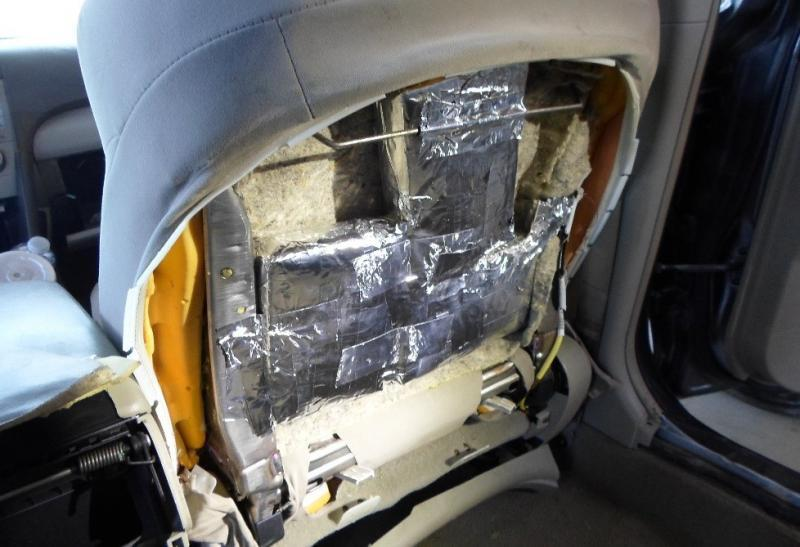 Agents uncover bundles of cocaine stashed inside a vehicle.