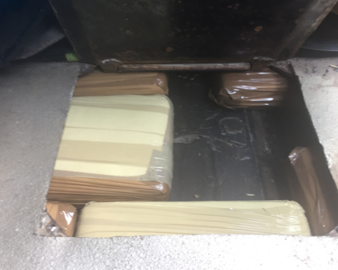 33 lbs. of cocaine were stashed inside car.