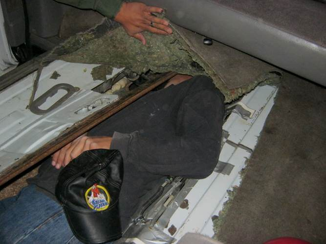 Man stuffed inside small compartment