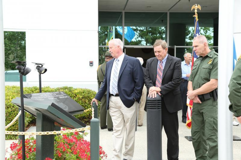 Retired Chief Patrol Agent Darryl Griffen, retired Congressman Duncan Hunter, Sr., and Chief Patrol Agent Richard Barlow view the fallen agent memorial at the USBP's 93rd anniversary celebration on May 25, 2017.