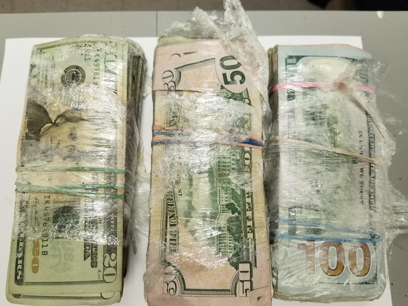 Border Patrol finds $18K in bulk cash and drugs hidden in car.