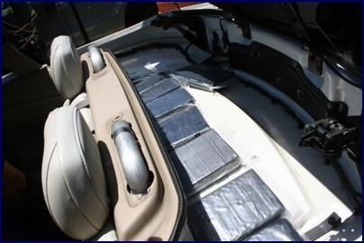 Twelve cellophane-wrapped bundles of narcotics found inside the convertible compartment of a 2004 Volvo.