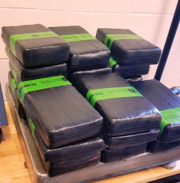 Woman was arrested after more than 50 lbs of cocaine was discovered in her car.
