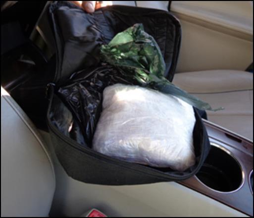 Two bundles of methamphetamine were found inside the console.
