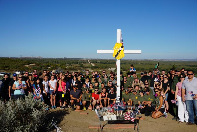 Before the relay began, a group photo was taken at the white cross where BPA Robert Rosas lost his life.