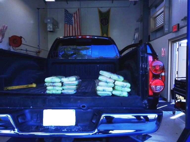 Bundles of hard narcotics worth around $440K found inside pick up truck.