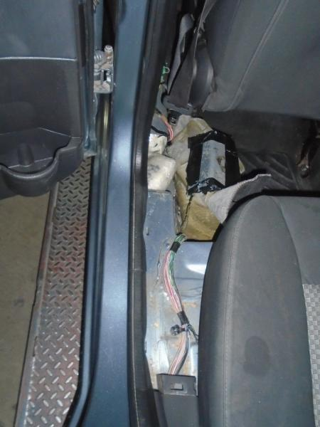 A combination of meth and cocaine were seized by officers after they were removed from the rocker panels of a smuggling vehicle