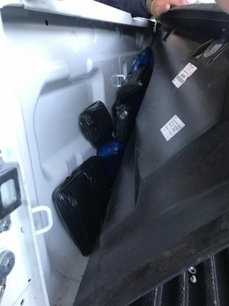A CBP canine alert to the bed of a smuggling vehicle, where more than 52 pounds of meth were removed