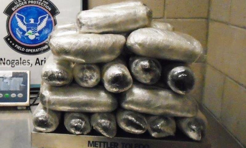 Officers removed nearly 54 pounds of meth from throughout a smuggling vehicle